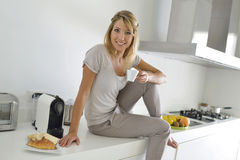 Woman at home having coffee Stock Photography
