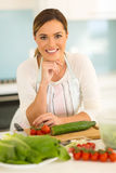 Woman in home kitchen Royalty Free Stock Image