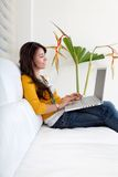 Woman at home with a laptop Royalty Free Stock Photography