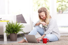 Woman at home with laptop Stock Photos