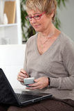 Woman at home with laptop royalty free stock photo