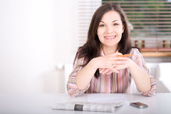Woman at home looking for a job Stock Photo