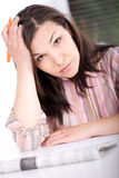 Woman at home looking for a job Stock Image