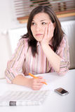 Woman at home looking for a job Stock Images