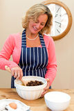 Woman at home making a cake. Stock Images