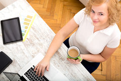 Woman in the home office Royalty Free Stock Images