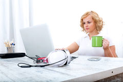 Woman in the home office. A plus size adult woman working in the home office Stock Photos