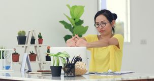 Woman in home office suffering from neck pain sitting at computer desk. Woman in home office is suffering from neck pain sitting at computer desk stock footage
