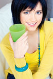 Woman at home. Pretty young woman with drink at home Stock Image