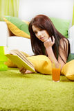 Woman at home reading a book Royalty Free Stock Photos