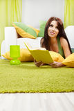 Woman at home reading a book Royalty Free Stock Photography