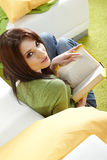 Woman at home reading a book Stock Photo