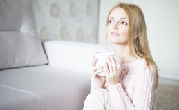 Woman at home relaxing Royalty Free Stock Photo