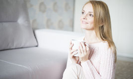 Woman at home relaxing Stock Photos