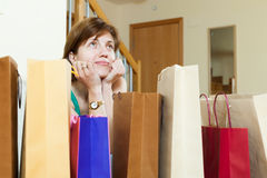 Woman at home with shopping bags Stock Photo