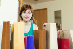 Woman at home with shopping bags Stock Photography