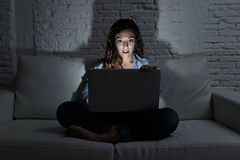 Woman at home sofa couch using laptop computer internet and network addiction concept Stock Image