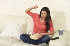 Woman at home sofa couch watching excited tv football sport celebrating victory Royalty Free Stock Photo