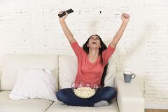 Woman at home sofa couch watching excited tv football sport celebrating victory Stock Images