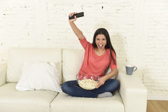 Woman at home sofa couch watching excited tv football sport celebrating victory Royalty Free Stock Photos