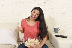Woman at home sofa couch watching excited tv football sport celebrating victory Stock Image