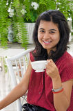 Woman at home with a tea from a cup Stock Images