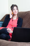 Woman at home using notebook Stock Photography