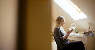 Woman at home using smartphone. Footage of a woman at home using smartphone. Woman texting stock video
