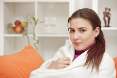 Woman at home wrapped in blanket Royalty Free Stock Photos