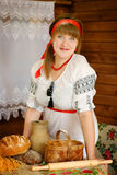 Woman with homemade baked goods Royalty Free Stock Image
