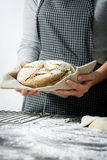 Woman with a homemade bread in their hands Royalty Free Stock Photo