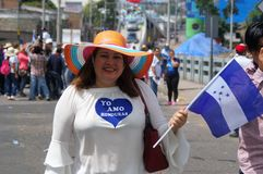 Labour Day Honduas Tegucigalpa March 2018. Woman with the Honduras flag on the Labour day protest 2018 royalty free stock photo