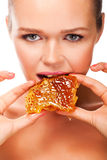 Woman with honey stock image