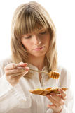 Woman with honey and bread Stock Image