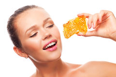 Woman with honeycomb Stock Image
