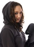 Woman in a hood. Young woman wearing boxing gloves and a hood against a white background stock photo