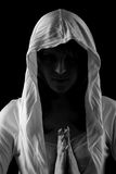 Woman in hood. Young beautiful woman in hood is praying Royalty Free Stock Image