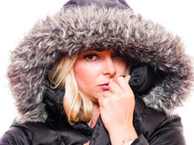 Woman in hood. A attractive blond woman is wearing a hood around her head royalty free stock images