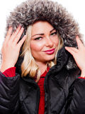 Woman in hood. A attractive woman is photographed wearing a winter coat with the hood royalty free stock photos