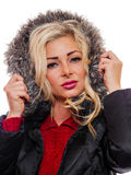 Woman in a hood. A attractive woman is wearing a winter coat with the hood pulled up around her face stock photos