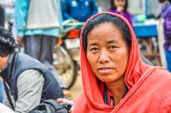 Woman with hood in Bihar. Bohdgaya, Bihar - circa January 2012: Woman with nice face has pink hood on her head during teachings in Bohdgaya, Bihar. Documentary Royalty Free Stock Images