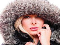 Woman in hood. Closeup portrait of a attractive caucasian woman wearing a winter coat with the hood pulled up stock photos