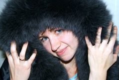 The woman in a hood from fur Stock Photo