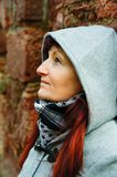 Woman with hood and scarf Stock Image