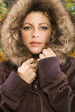 Woman in hooded coat. Stock Photos