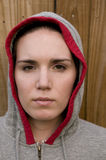 Woman with Hoodie. Against a wood background Royalty Free Stock Photo