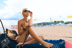 Woman with hookah on the beach Royalty Free Stock Photos