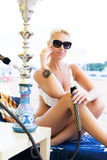 Woman with hookah on the beach Royalty Free Stock Image
