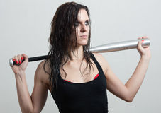 The woman the hooligan holds baseball bat Royalty Free Stock Photography