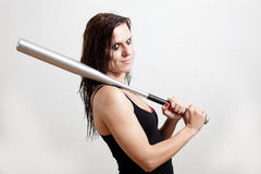 The woman the hooligan holds baseball bat Stock Image